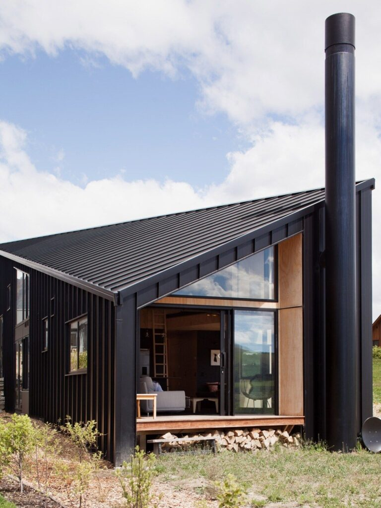 Modern tiny cabin with wood finish and concrete floors